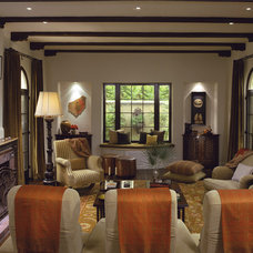 Mediterranean Family Room by Tommy Chambers Interiors, Inc.