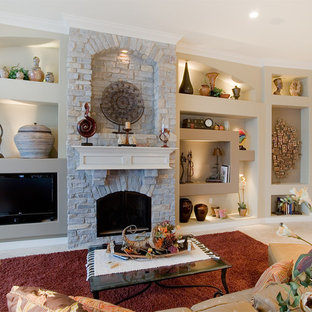 Large tuscan open concept ceramic tile family room photo in Chicago with beige walls, a standard fireplace, a stone fireplace and a media wall