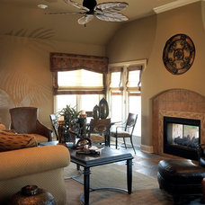 Mediterranean Family Room by Curt Hofer & Associates