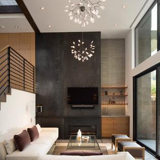 サンフランシスコのミッドセンチュリースタイルのおしゃれなファミリールーム (ホームバー、コンクリートの床、金属の暖炉まわり、壁掛け型テレビ、横長型暖炉) の写真