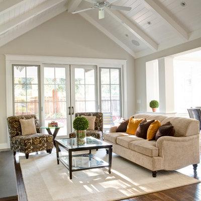 Elegant open concept dark wood floor family room photo in San Francisco with beige walls