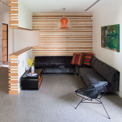 Example of a small trendy open concept concrete floor family room design in Melbourne with white walls, no fireplace and no tv