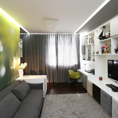 Inspiration for a contemporary enclosed family room remodel in Other with green walls and a wall-mounted tv