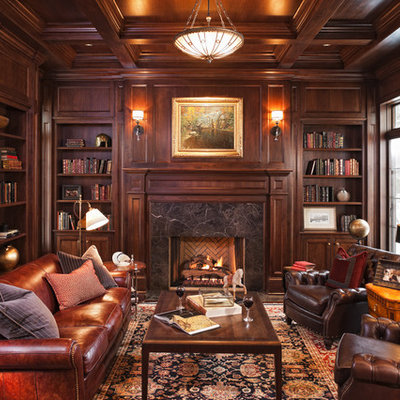 Inspiration for a timeless enclosed family room library remodel in Minneapolis with brown walls, a standard fireplace and no tv