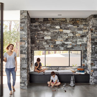 Inspiration for a modern open concept family room in Sunshine Coast with concrete floors and grey floor.