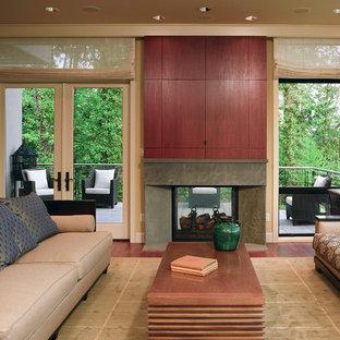 シアトルのコンテンポラリースタイルのおしゃれなファミリールーム (ベージュの壁、両方向型暖炉、石材の暖炉まわり、内蔵型テレビ) の写真