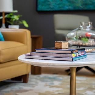 Inspiration pour une salle de séjour vintage de taille moyenne et ouverte avec un mur blanc, un sol en bois clair, une cheminée standard, un manteau de cheminée en carrelage, un téléviseur dissimulé et un sol jaune.