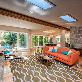 Mid-century modern family room photo in Other