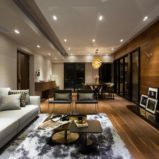 Trendy family room photo in Hong Kong with beige walls, no fireplace and a wall-mounted tv