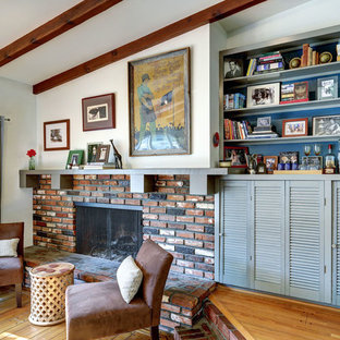 Midcentury modern family room photo in Los Angeles with a standard fireplace, a brick fireplace and white walls