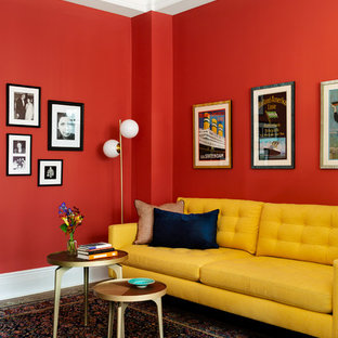 Example of a midcentury modern family room design in New York with red walls