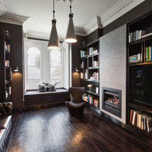 Design ideas for a mid-sized contemporary enclosed family room in Melbourne with a library, a standard fireplace, a stone fireplace surround, brown floor, grey walls, dark hardwood floors and a built-in media wall.