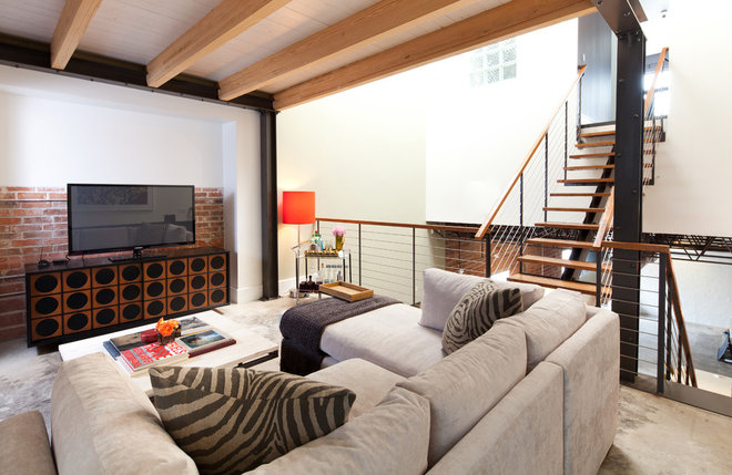 Industrial Family Room by Laura U, Inc.