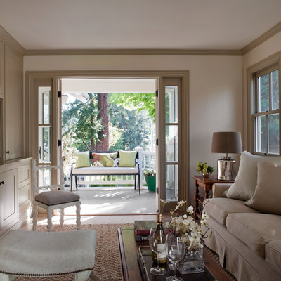 Family room - traditional enclosed family room idea in San Francisco with beige walls, no fireplace and a media wall