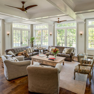 Family room - large country open concept brown floor and dark wood floor family room idea in Philadelphia with beige walls