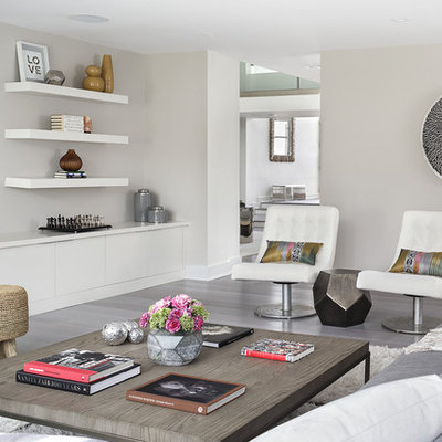 Trendy enclosed gray floor family room photo in New York with gray walls, no fireplace and a wall-mounted tv