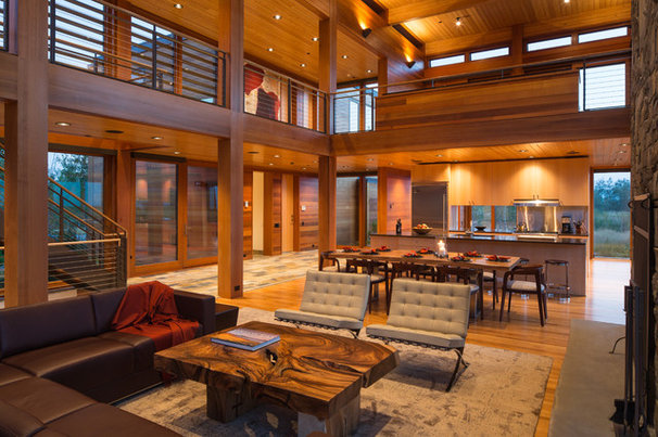 Rustic Family Room by Teton Heritage Builders
