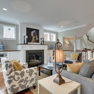 Example of a large transitional open concept medium tone wood floor family room design in Minneapolis with gray walls, a standard fireplace, a stone fireplace and no tv