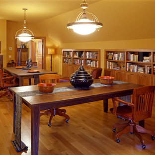 Example of a huge transitional loft-style medium tone wood floor family room library design in Minneapolis with yellow walls, no fireplace and no tv