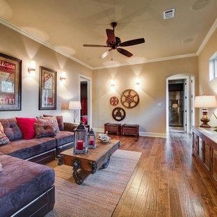 Family room - mediterranean brown floor family room idea in Austin
