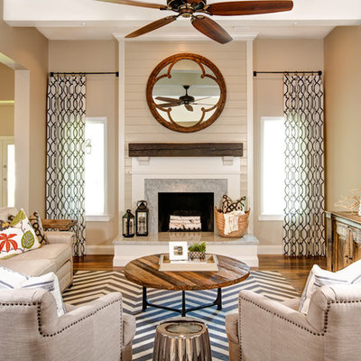 Inspiration for a rustic open concept medium tone wood floor family room remodel in Phoenix with beige walls, a standard fireplace and a wall-mounted tv