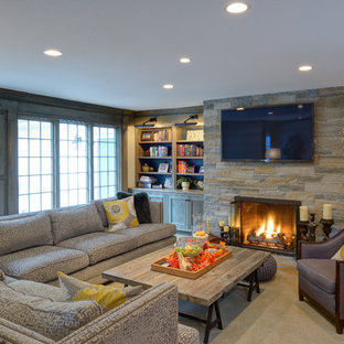 Example of a mid-sized classic open concept carpeted family room design in Boston with a stone fireplace, a wall-mounted tv and a standard fireplace