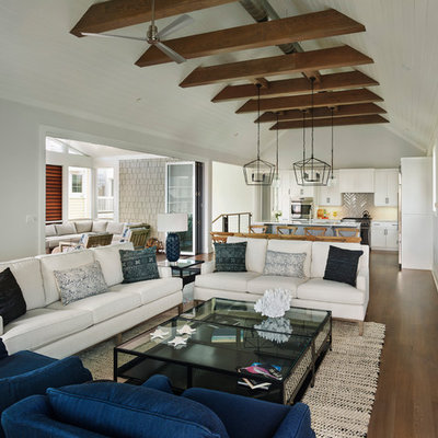 Inspiration for a large coastal open concept medium tone wood floor family room remodel in Other with gray walls, a stone fireplace, a wall-mounted tv and a ribbon fireplace