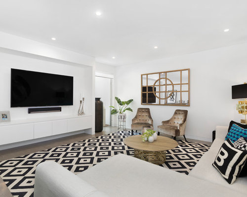 Photo Of A Contemporary Family Room In Sydney With White Walls, A  Wall Mounted