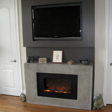 Modern Indoor Fireplaces by Concrete Elegance Inc.