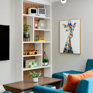 Example of a mid-sized trendy family room design in Minneapolis with gray walls, no fireplace and a wall-mounted tv