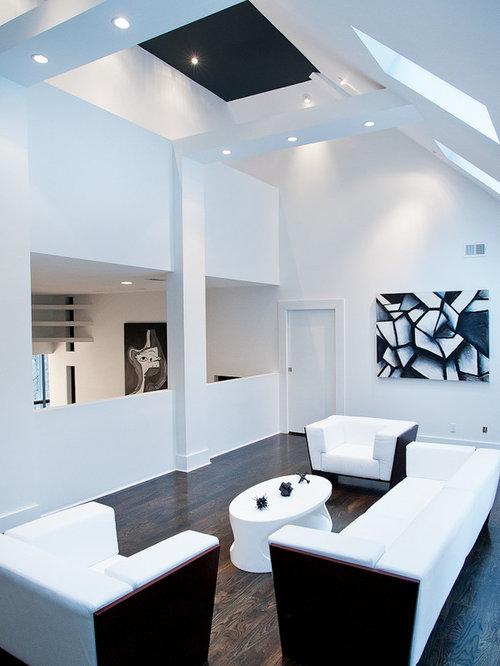 dark wood floor family room. Example of a minimalist brown floor and dark wood family room design  in Nashville with White Wall Dark Floor Houzz