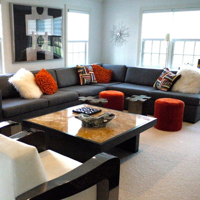 Family room - large modern enclosed family room idea in New York with white walls