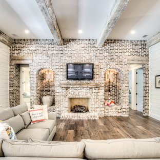 Cottage enclosed family room photo in Atlanta with white walls, a standard fireplace and a brick fireplace