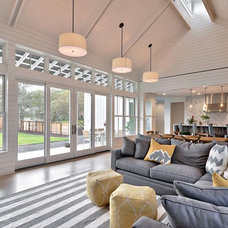 Farmhouse Family Room by Tim Brown Architecture