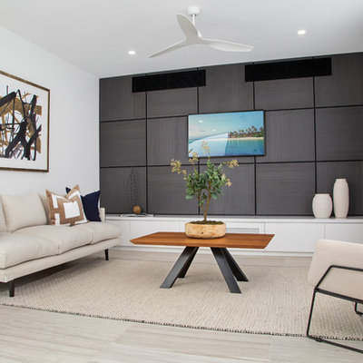 Small trendy open concept porcelain tile and gray floor family room photo in Gold Coast - Tweed with a wall-mounted tv and white walls
