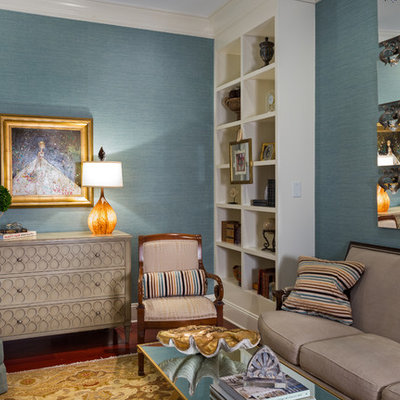 Example of a classic enclosed family room design in Charlotte with blue walls