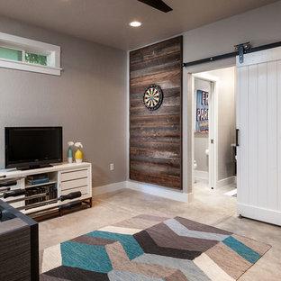 Ispirazione per un soggiorno minimal di medie dimensioni e aperto con sala giochi, pareti grigie e pavimento in cemento
