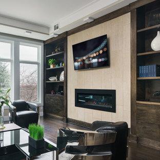 Ispirazione per un soggiorno minimalista di medie dimensioni e stile loft con parquet scuro, camino sospeso, cornice del camino piastrellata, TV a parete e pavimento marrone