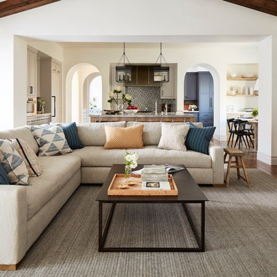 Family room - transitional open concept dark wood floor and brown floor family room idea in San Francisco with white walls