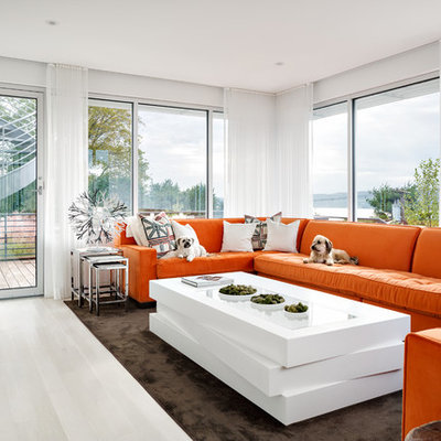 Mid-sized trendy enclosed light wood floor and white floor family room photo in New York with white walls, a wall-mounted tv and no fireplace