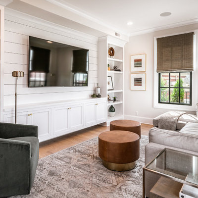 Inspiration for a transitional light wood floor family room library remodel in Louisville with gray walls, no fireplace and a media wall