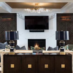 Cette photo montre une très grand salle de séjour tendance ouverte avec un mur blanc, un sol en bois foncé, une cheminée standard, un manteau de cheminée en pierre, un téléviseur fixé au mur, un sol marron, un plafond décaissé et du lambris.