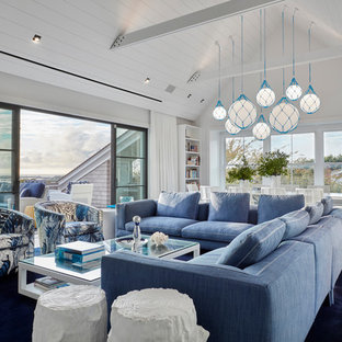 Inspiration for a beach style open concept carpeted and blue floor family room remodel in New York with white walls