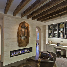 Rustic Family Room by Conrado - Home Builders