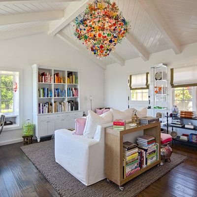 Trendy dark wood floor family room photo in Santa Barbara with white walls and no fireplace