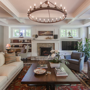 Inspiration for a large transitional open concept dark wood floor and brown floor family room remodel in Cincinnati with white walls, a standard fireplace, a stone fireplace and a wall-mounted tv
