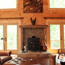 Rustic Family Room by Summit Custom Homes