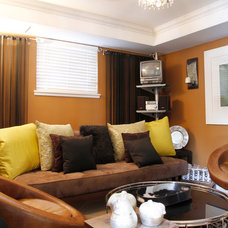 Eclectic Family Room by Esther Hershcovich