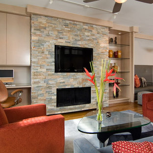 Trendy open concept medium tone wood floor family room photo in Houston with a ribbon fireplace and a stone fireplace