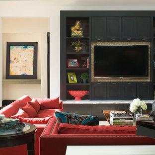 Esempio di un soggiorno minimal con pareti beige e parete attrezzata